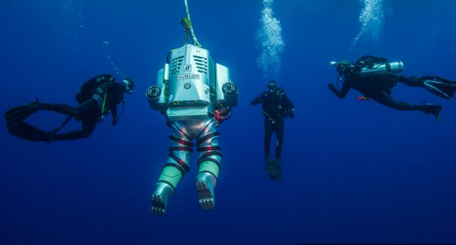 Creating history, with members of the Hellenic Navy Seal (O.Y.K) team providing in-water support for the Exosuit.